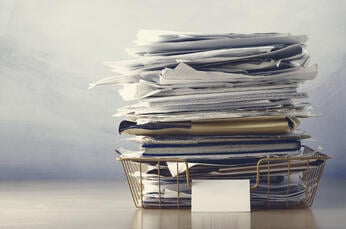 pile of recruitment onboarding paperwork